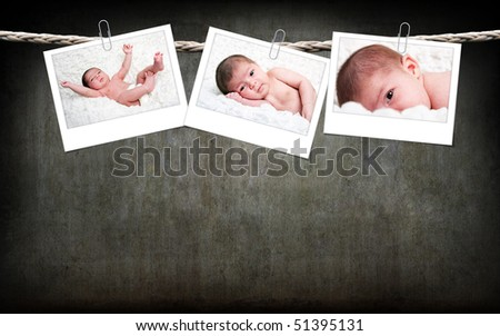 Three funny cute Caucasian Hispanic baby photos with white frame hanging on rope with paperclips on a gray grunge background.