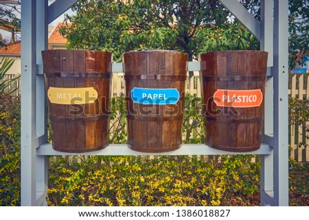 Three garbage baskets for selective collection in barrel format of wine. Foto stock ©