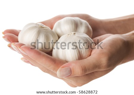 three garlic heads in woman hand isolated