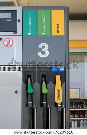 Three gas pump nozzles for gas and diesel on a petrol station