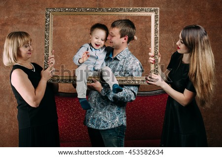 detail three generation family sitting on sofa together classic portrait in a frame 453582634