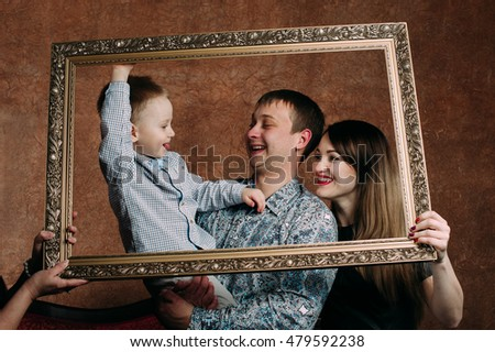 detail three generation family sitting on sofa together classic portrait in a frame 479592238