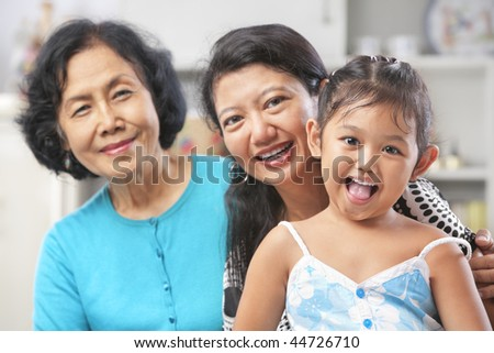 Three generation of Asian females posing at home starting from grandma, mother and daughter