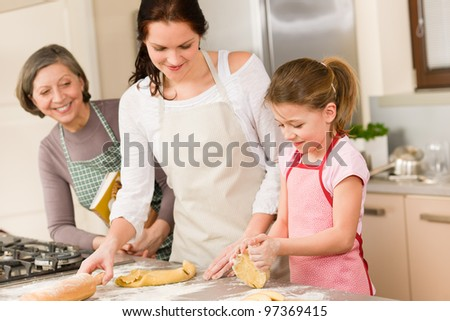 Three generation of happy women baking in kitchen prepare dough