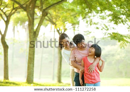 Three generations family having fun at outdoor - stock photo