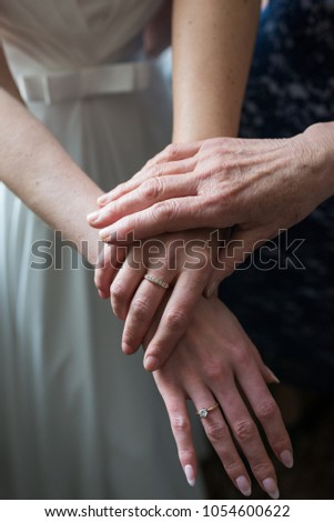 Three generations. Hands daughters, moms and grandmothers. Wedding morning
