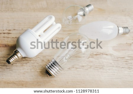 Three generations of light bulbs. Regular incandescent, energy saving fluorescent and LED isolated on white background with clipping path