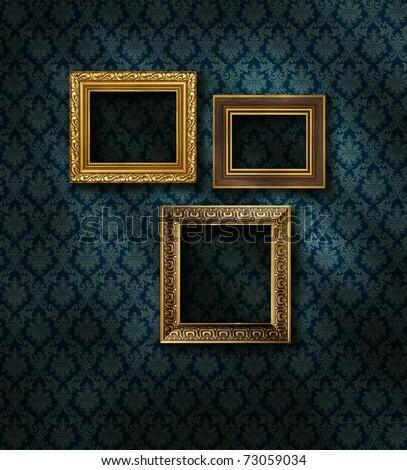 Three gilded frames on dark damask pattern wall paper