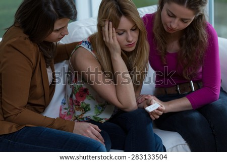 Three girl friends trying to solve a difficult pregnancy problem