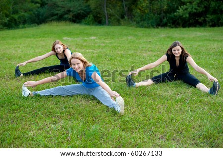 Three girl work out in nature