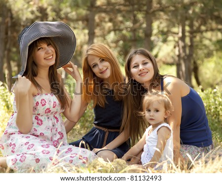 Three girlfriends and little child at the park.