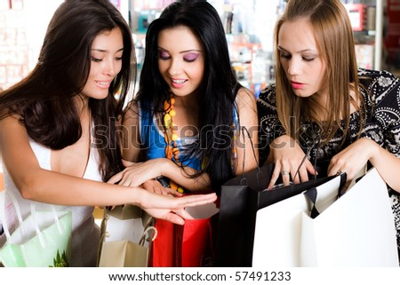 Three girls are  shopping