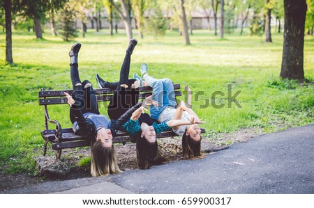 three girls being silly by...