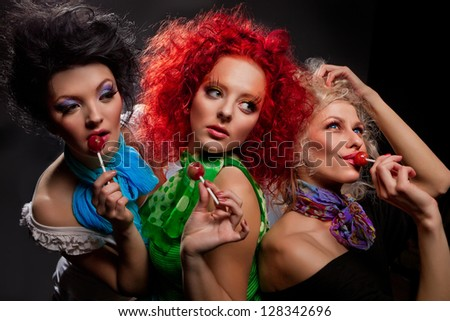 Three  glamour girls with lollipops.