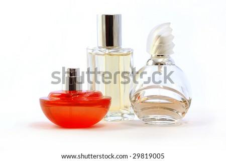 Three glass bottles of perfume on white background