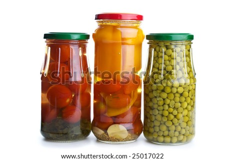 Three glass jars with marinated vegetables (green peas, tomatoes, bell pepper, e.t.c.) isolated on the white background