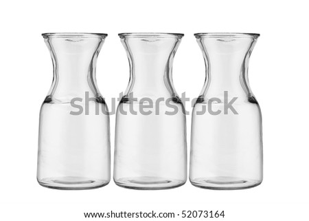 Three glass jugs arranged on white background