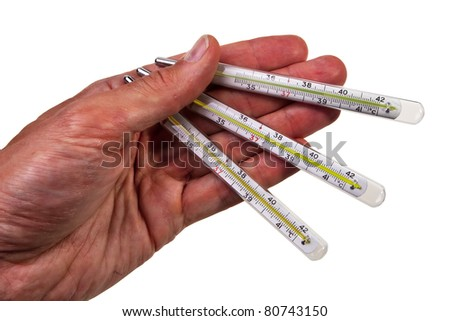 Three glass mercury thermometers hold by male hand isolated over white background.
