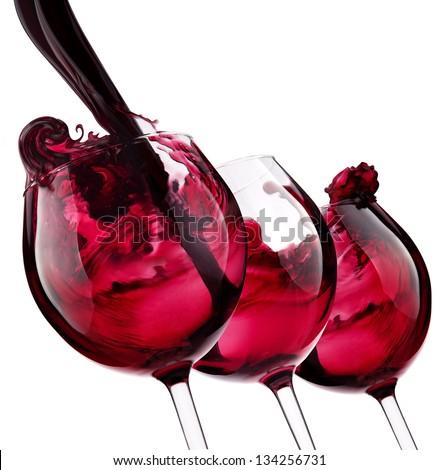three glass with red wine splash - stock photo