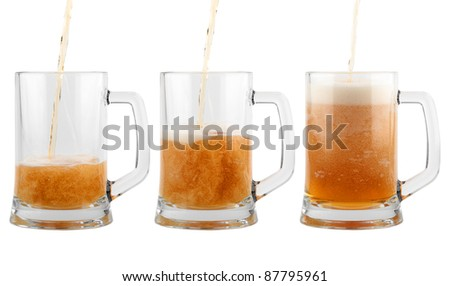 Three glasses of beer isolated on white background.