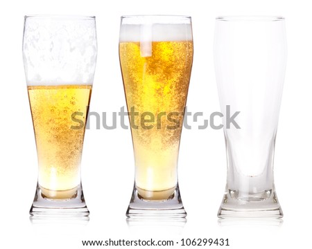 Three glasses of beer with one full, one half gone, and one empty isolated on a white background.