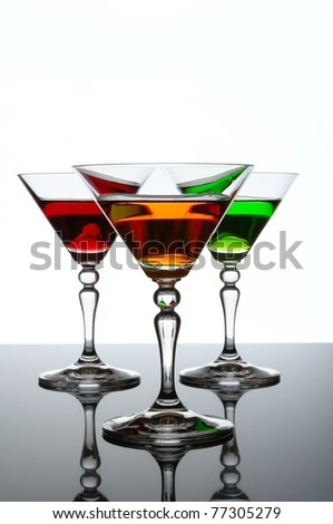 Three glasses of cocktail isolated on white