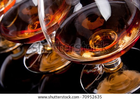 Three glasses of cognac in a row