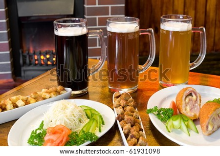 three glasses of different beer with snack