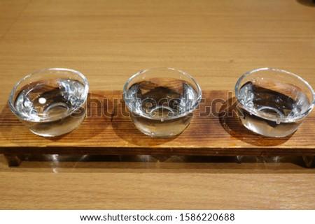 Three glasses of Japanese sake (Japanese food)