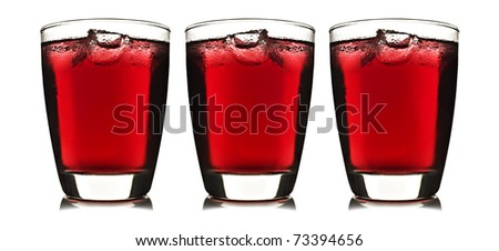 Three glasses of red fruit juice with ice on white background