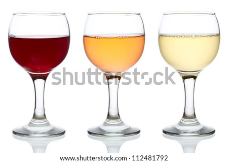 Three glasses of red, rose and white wine isolated on white