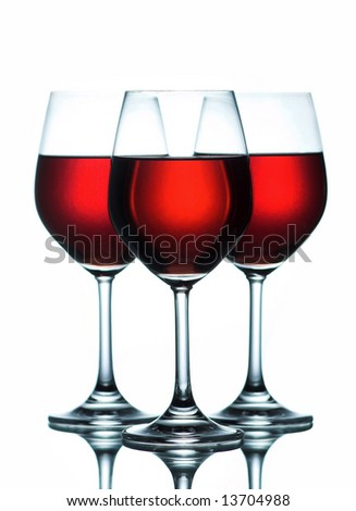 three glasses of red wine isolated on white
