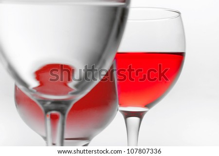 three glasses of red wine on it is white background and and place for text background - stock photo