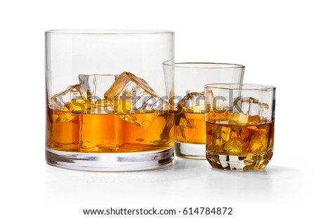 three glasses of whiskey isolated on white with clipping path #614784872