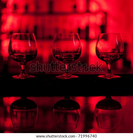Three glasses of whiskey on the bar - stock photo
