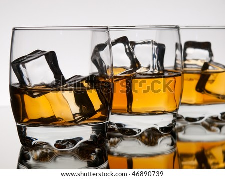 Three glasses of whiskey on the rocks