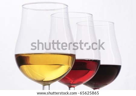 Three glasses of wine, red, rose and white, isolated on white background