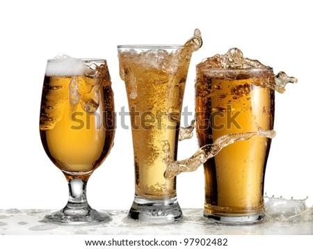 Three glasses with beer splash
