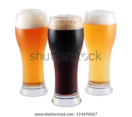 three glasses with different types of blond beer toast and isolated black and with clipping path