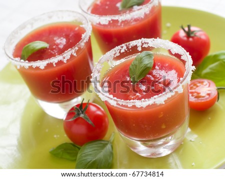 Three glasses with fresh gazpacho (cold tomato soup).