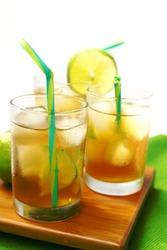 Three Glasses with ice tea and green lemon