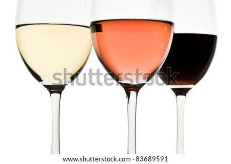 three glasses with white, rose and red wine - stock photo