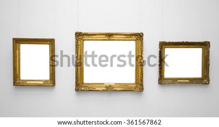 three gold empty frame on white ...