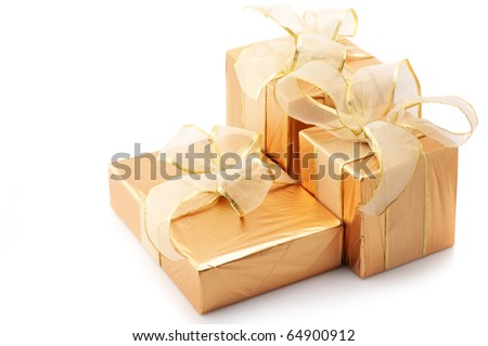 Three gold foil gifts with golden bows isolated on white background.