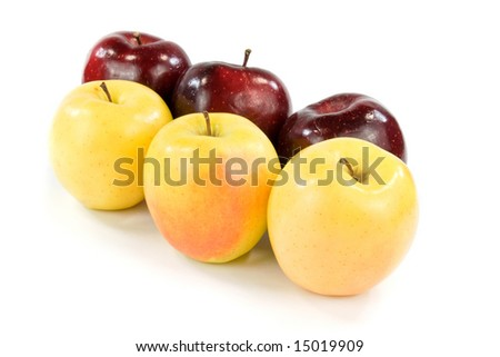 Three Golden And Three Red Delicious Apples On White Background