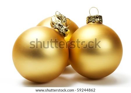 three golden dull christmas balls on white background