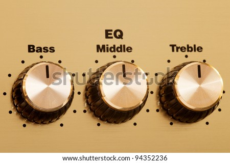 http://image.shutterstock.com/display_pic_with_logo/874921/874921,1328400891,1/stock-photo-three-golden-equalizer-knobs-for-bass-middle-and-treble-94352236.jpg