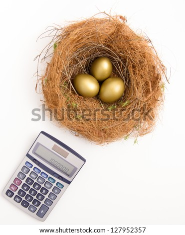 Three golden nest eggs and a calculator.