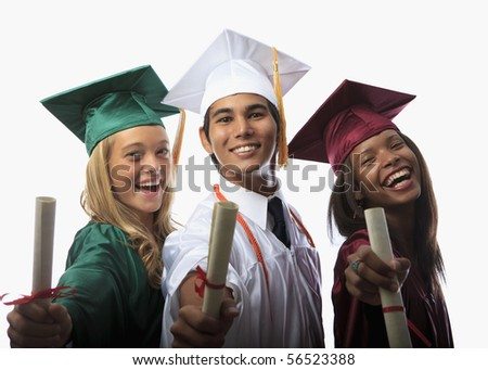 three graduates in cap and gown with diplomas - stock photo