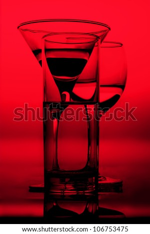 three graphic glasses of red wine of white wine on it is black ared background silhouettes in a bright wine shades of black outlines